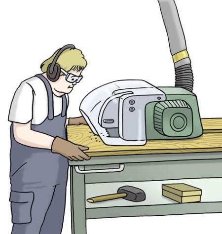 Eine Person arbeitet an einer Maschine