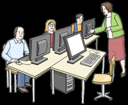 3 Personen sitzen an Computern, eine Frau erklärt etwas